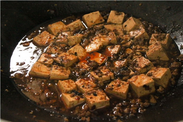 , evenly sprinkle the ground Sichuan peppercorn on top of dished tofu ...